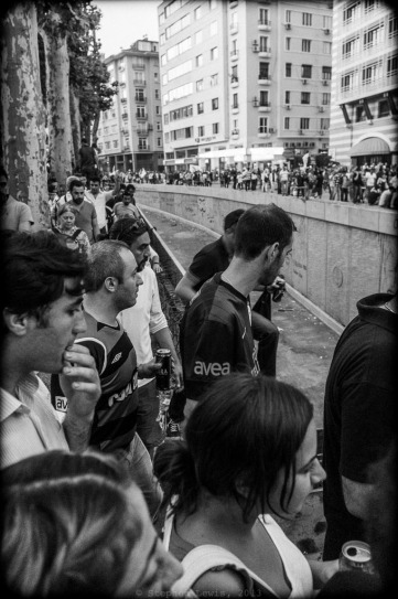 Marchers approaching Gezi Park from Osman Bey and Harbiye; Istanbul, early-June, 2013. In the center, the uncompleted open trench for an automobile underpass under and through Taksim Square, the main element in the road widening project that initially sparked the Gezi Park occupation. (Fuji X100). Click on image to enlarge.