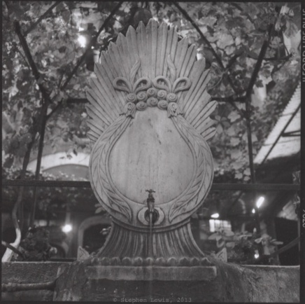 Fountain, seemingly from late-18th-century spolia, Zincirli Han, Kapalı Çarşıı, Istanbul, ca. 2000. (Rolleiflex Xenotar 2.8, Ilford XP2, scan of print.) Click to enlarge.