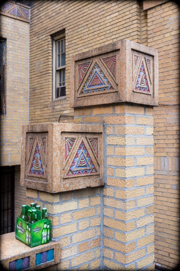 Detail, Service Entrance, Mayan-inspired terracotta tiles, Park Plaza Apartments, Jerome Avenue, Highbridge Heights, Bronx, New York.  Constructed: 1929-1931.  Architects: Horace Ginsbern, Marvin Fine. The six-pack of Heineken is fortuitous.  2012. (Fuji X100). Click to enlarge.