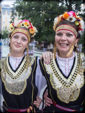 Two members of an amateur folk dance troupe following a performance at an outdoor dance event for children, downtown Sofia, Bulgaria, 2013. (Fuji X100, vertical crop from horizontal frame) Click to enlarge.