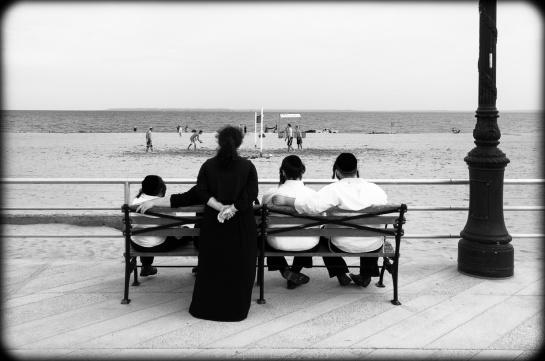 A Brighton Beach sabbath afternoon. Ultra-orthodox Jews gazing at volley ball and the horizon; Brighton Beach, Brooklyn, New York, 2012. (Fuji X100). Click to enlarge.