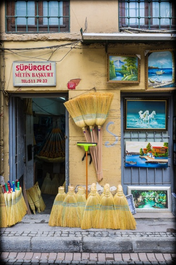Left: The wares of a broom seller with matching façade. Right: Affordable art.  Tahtakale, Eminönü, Istanbul, 2012. (Fuji X100). Click to enlarge.