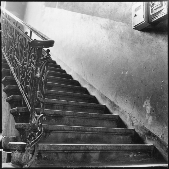 Stairway, vicinity of the Women's Market, the outdoor market of Sofia, Bulgaria, 1998. (Rolleiflex Tessar f3.5, Ilford HP5.) Click on image to enlarge