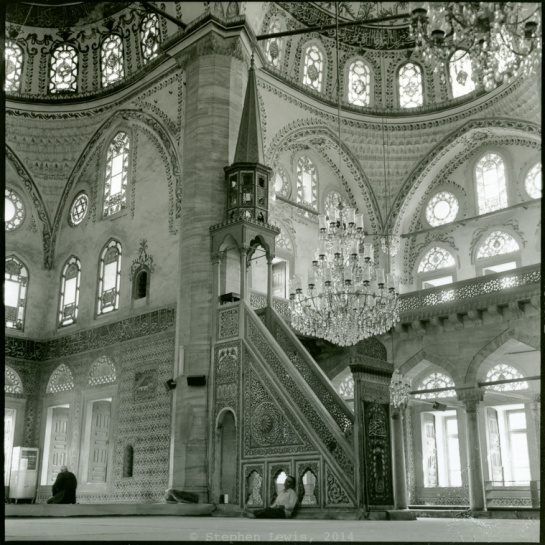 The Mosque of Hekimoğlu Ali Paşa, Istanbul (view towards minber). +/-2000.  The figure at prayer at the lower left and the figure seated at center provide scale. (Rolleiflex Tessar 3.5, 400ASA B/W negative, scan of print). Click on image to enlarge.
