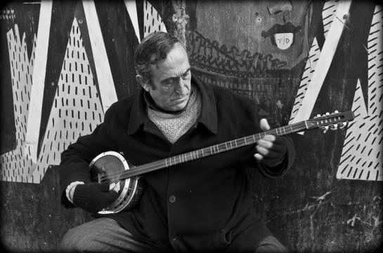 Musician playing tambur, Istiklal Caddesi, Istanbul, 2012. Fuji X100.  Click on image to enlarge.