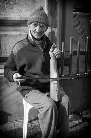Keman player, istiklal Caddesi, Istanbul, 2012. Fuji X100. Click on image to enlarge.