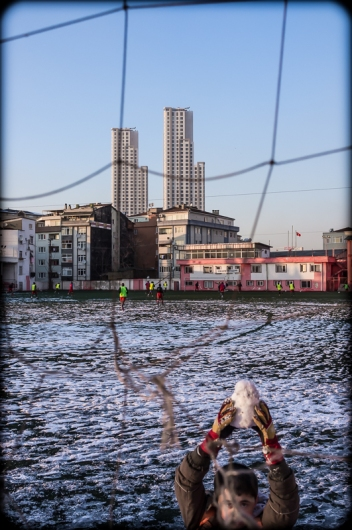 The upper stories of the Ant Hill Towers apartment complex, as seen from a football field at the heights Feriköy, Istanbul, 2012. (Fuji X100). Click on image to enlarge.